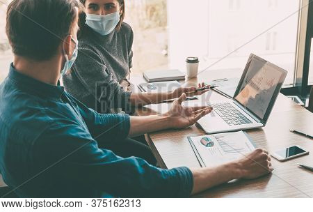 Business Colleagues Work In The Office During The Quarantine Period.