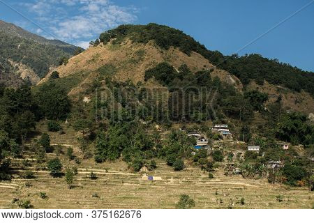 Village By Rice Fields On A Hillside At Annapurna Circuit, Nepal