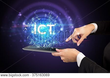 Close-up of a touchscreen with ICT abbreviation, modern technology concept