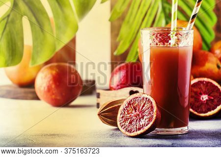 Summer Juice Or Non-alcoholic Refreshing Healthy Cocktail Or Drink From Freshly Squeezed Red Sicilia