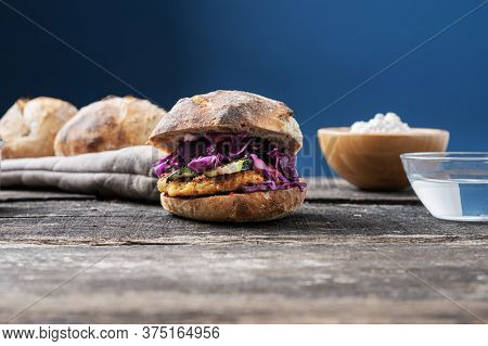 Low Angle View Of Delicious Home Made Vegan Burger With Sourdough Bread, Chickpea Burger And Lots Of