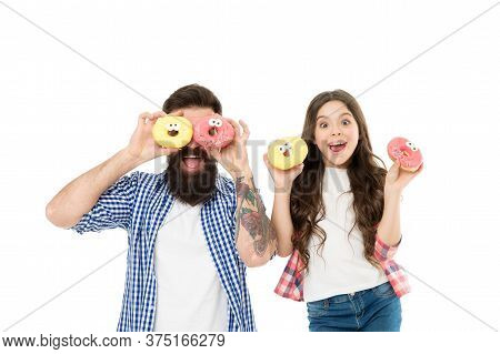 Sweets And Treats Concept. Daughter And Father Eat Sweet Donuts. Happiness And Joy. Buy More Sweets.