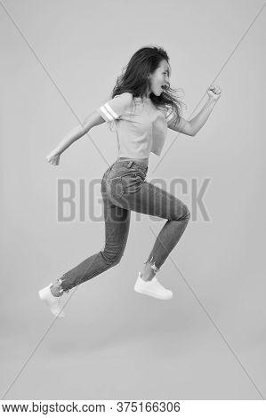 Run Hard To Arrive At Goal. Dynamic Woman Run Yellow Background. Sexy Girl Jump With Long Run. Energ