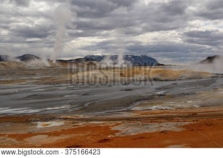Mars-like Volcanic Reddish Landscape With Steaming Volcanic