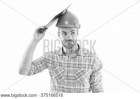 Mind Your Head. Mind Your Safety. Builder In Safety Helmet Protect Head With Clipboard. Construction