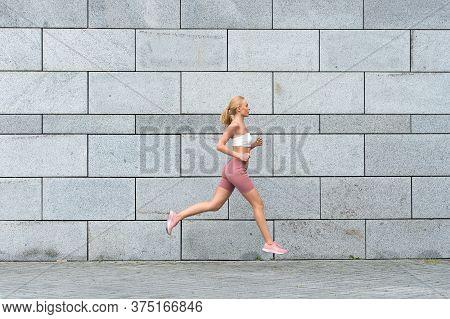 Sport Tells To Keep Moving Forward. Sexy Sportswoman Run Outdoors. Enjoying Sport Activities. Physic