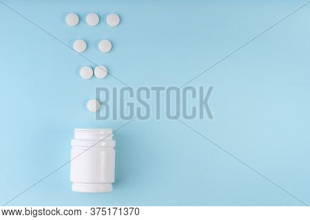 Exclamation Point Sign, Mark From Pharmaceutical Medicine Pills. Creative Layout Of Tablets And Bott