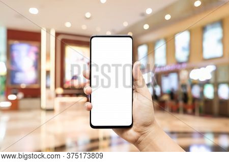 Mockup Blank White Screen Mobile Phone Hand Holding Smartphone  With Blurred Image Hall Of Ticket Sa