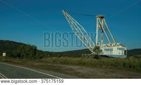 Undara To Townsville Highway, Queensland, Australia - June 2020: Industrial Crane On Side Of Road On