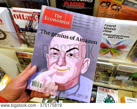 Montreal, Canada - June 30, 2020: The Genius Of Amazon Title And A Picture Of Jeff Bezos As The Dr E