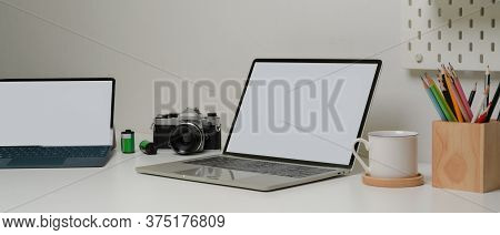 Modern Home Worktable With Mock-up Laptop, Tablet, Stationery, Camera And Coffee Cup