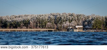 A Clear Cold Windy Morning At The Boathouse At Lake Johnson Park In Raleigh, North Carolina. Snow-co