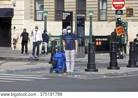 Bronx, New York/usa - May 18, 2020: Man With Cart Of Laundry While Wearing Face Mask During Covid-19