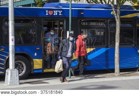 Bronx, New York/usa - May 20, 2020: Riders Leave Public Bus Wearing Masks During Covid-19 Pandemic.