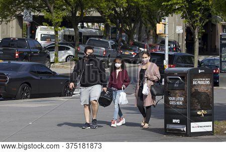 Bronx, New York/usa - May 20, 2020: People Walk Outside Wearing Protective Masks During Covid-19 Pan