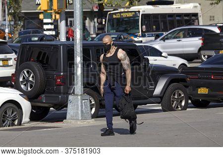Bronx, New York/usa - June 2, 2020: Muscular Man Wears Mask During Covid-19 Pandemic.
