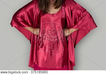 Illustration Of Internal Organs On A Woman's Body In A Red Satin Nightgown On Gray Background