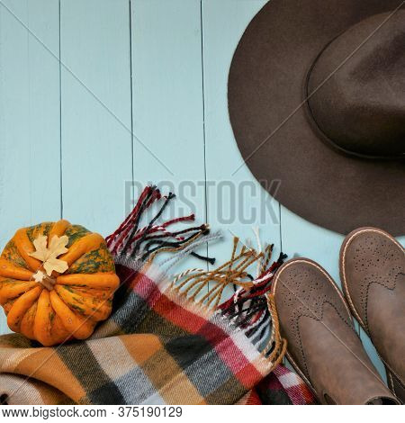 Autumn Discounts And Sales Background.fall Fashion.brown Felt Hat, Boots And Checkered Scarf, Pumpki