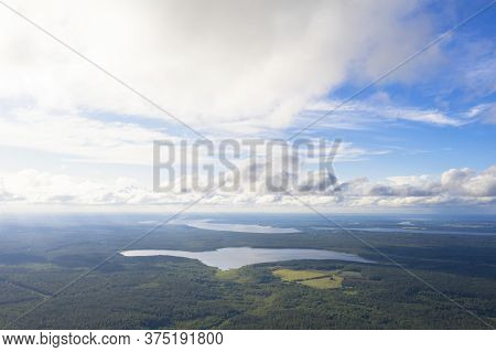 Aerial View Clouds Over The Forest And Lake. View From Drone. Aerial Top View Cloudscape. Texture Of