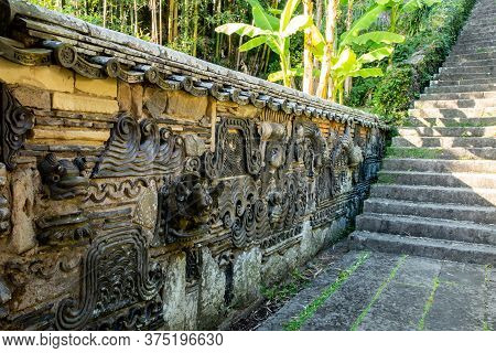 Decorative Carved Stone Wall In A Buddhist Temple In Nagasaki, Japan.