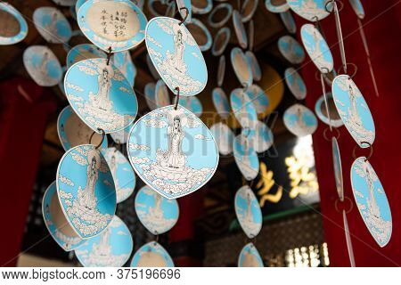 Blue Paper Decorations In Buddhist Temple In Nagasaki, Japan.
