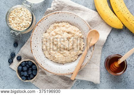 Healthy Breakfast Oatmeal Porridge With Fruits, Berries And Honey. Rolled Oats Porridge. Clean Eatin