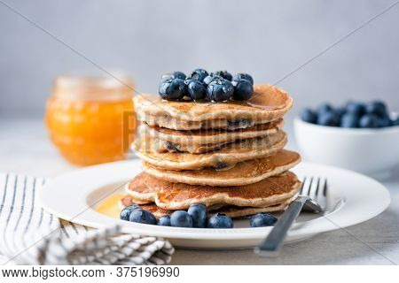 Whole Wheat Pancakes With Blueberries And Honey On A Plate. Tasty Breakfast Food, Stack Of Homemade