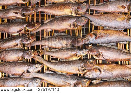 Smoked Fish. Smoke. Hot Smoked Fish Meat. Smoked Fish. Perch. Smoked Fish Background Texture.