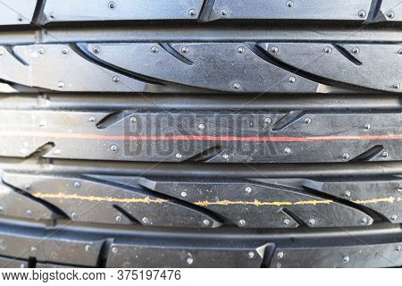 Summer Car Tire. Tire Stack Background. Car Tyre Protector Close Up View. Black Rubber Tire Backgrou