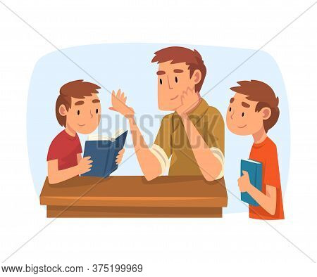 Father Teaching His Sons, Parent Helping Boys With Homework And Explaining Lesson In Textbook, Home