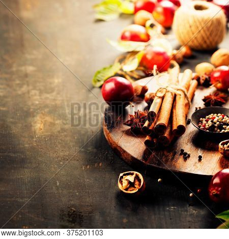 Apples and spices, autumn or winter cooking concept apple pie, cider, vinegar or mulled wine , copy space