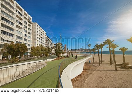 Benidorm, Alicante, Spain - November 27, 2019: People Walk Along The Fantastic Modern Promenade Of P