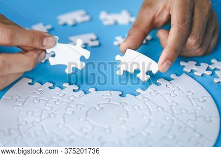 Jigsaw Connection,  Jigsaw Puzzle In The Hand Of A Businessman,  Business Team Assembling Jigsaw Puz