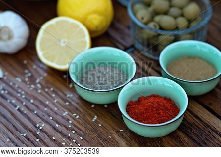 Oriental Spices Cumin, Ground Zira And Red Pepper Paprika In Bowls On A Wooden Oak Table. Soft Selec
