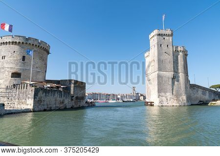 La Rochelle , Aquitaine / France - 11 19 2019 : La Rochelle Walled Entry Port Tower Of The Chaine An