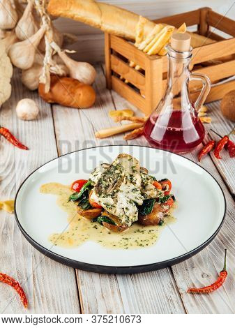 Gourmet Cooked Pike-perch Fish Fillet With Spinach In A Creamy Sauce, Vertical