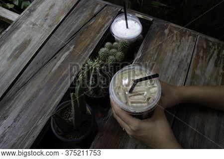 Hand On Iced Coffee Drink, Stock Photo