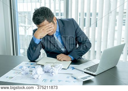 Businessman Acted With Tired Stress Anxiety From The Frustrated Business Crisis, Paperwork Paper Cub