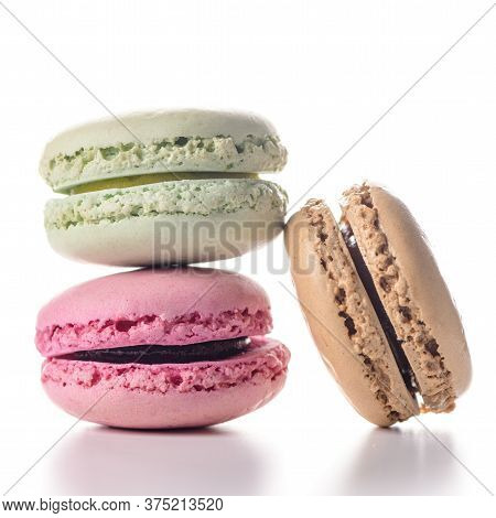 Three Delicious And Colorful Macaroons On White Background.