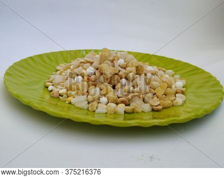 Pile And Heap Of A Pongal Traditional Raw Mixtures Of Ellu Bella In A Green Plate Isolated On White