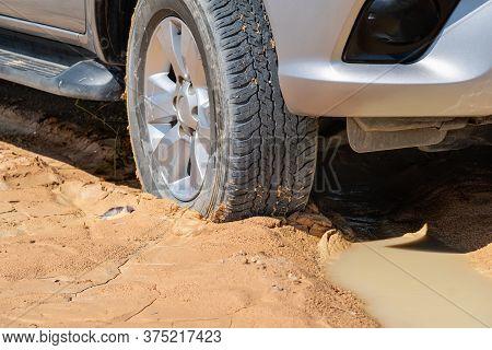 Big Car Stuck In Muddy  Country Road