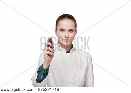 A Woman Doctor In A White Coat Uses An Antiseptic, An Antiseptic In A Spray.