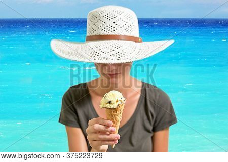 Young Woman Eating Ice Cream And Summer Hat