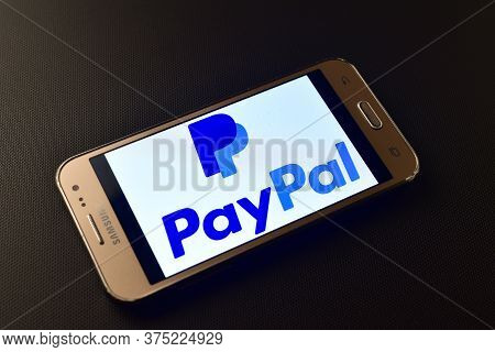 Italy - February 10, 2019:  Paypal Logo On Smartphone Screen. Paypal Is An American Online Payment A