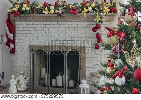 Beautiful Holdiay Decorated Room With Christmas Tree. Burning Fireplace. Decorated Festive Fireplace