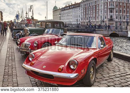 23 September 2018: Copenhagen, Denmark - Vintage And Classic Cars Lined Up On The Quay Ay Nyhavn. Th