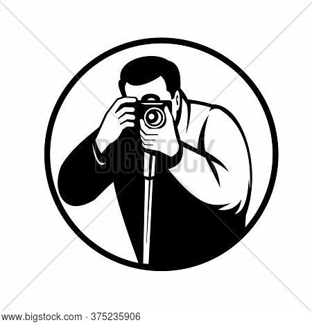 Black And White Retro Style Illustration Of A Photographer Shooting With Digital Slr Camera Viewed F