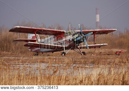 An-2, A Small Propeller Piston Biplane Aircraft At A Airfield Autumn, Retro Old Plane,  The Inscript