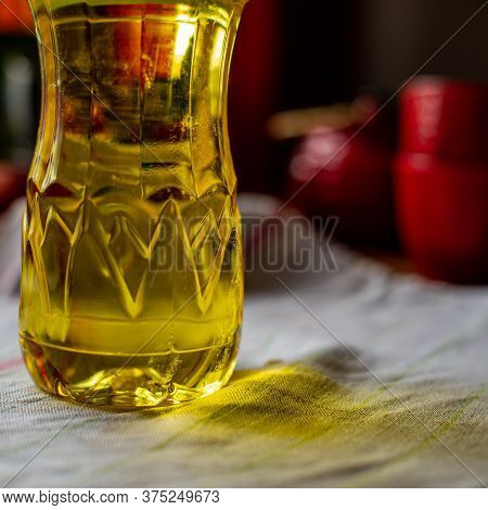 Bottle Of Fresh Sunflower Oil Stands On The Background Of Dishes In The Kitchen. Cooking Food.