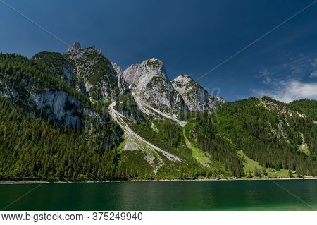 Wiew From Lake Shore Up To Well Known Ferrata In The Austrian Alps Intersport Klettersteig At Gosaus